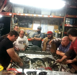 J.C Elrod and the gang working out the final kinks in the car before its first race. This would be a typical Wednesday night scene at the shop in San Martin. Photo courtesy Connor Quinn